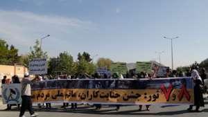Protestors denounce communist, Taliban regimes